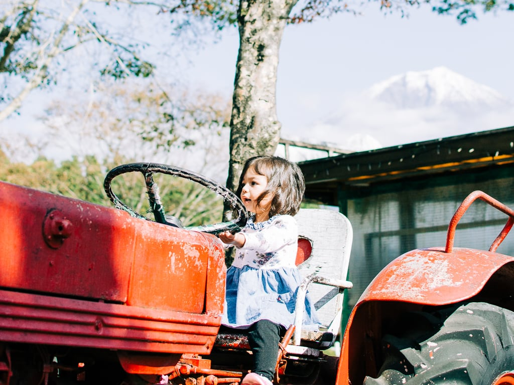 Riding the farm tractor